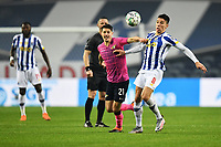 3rd January 2021; Dragao Stadium, Porto, Portugal; Portuguese Championship 2020/2021, FC Porto versus Moreirense; Mateus Uribe of FC Porto brings down the ball to control and holds off Filipe Soares of Moreirense
