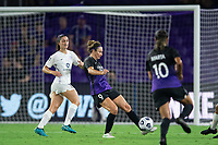 ORLANDO, FL - SEPTEMBER 11: Jodie Taylor #9 of the Orlando Pride kicks the ball during a game between Racing Louisville FC and Orlando Pride at Exploria Stadium on September 11, 2021 in Orlando, Florida.