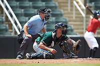 Greensboro Grasshoppers catcher Will Allen (33) sets a target as home plate umpire Brandon Blome looks on during the game against the Kannapolis Intimidators at Kannapolis Intimidators Stadium on August 5, 2018 in Kannapolis, North Carolina. The Grasshoppers defeated the Intimidators 2-1 in game one of a double-header.  (Brian Westerholt/Four Seam Images)