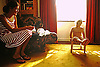 Mother and young son backlit from sunny window and a victorian sofa with a drop down end.<br /> <br /> Stock Photo by Paddy Bergin