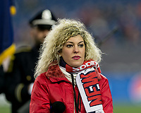 Foxborough, Massachusetts - April 6, 2018: In a Major League Soccer (MLS) match, New England Revolution (blue/white) defeated,4-0, Montreal Impact (white), at Gillette Stadium.<br /> National anthems singer.