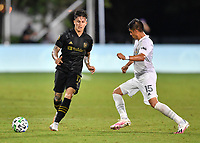 LAKE BUENA VISTA, FL - JULY 18: Brian Rodríguez #17 of LAFC passes the ball away before a challenge by Joe Corona #15 of LA Galaxy during a game between Los Angeles Galaxy and Los Angeles FC at ESPN Wide World of Sports on July 18, 2020 in Lake Buena Vista, Florida.