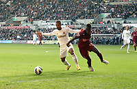 Pictured: Swansea's Wayne Routledge takes on Mapou Yanga-Mbiwa in a race to the ball<br />