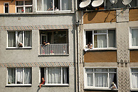 Turkish ladies leaning our of windows in Beyoglu, Istanbul, Turkey