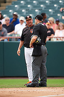 Bowie Baysox manager Gary Kendall (35) questions a call with umpire Brian Peterson during the first game of a doubleheader against the Akron RubberDucks on June 5, 2016 at Prince George's Stadium in Bowie, Maryland.  Bowie defeated Akron 6-0.  (Mike Janes/Four Seam Images)