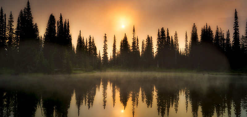 Sunrise and fog on Reflection Lake. Mt. Rainier National Park, Washington