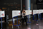 BROOKLYN, NY — OCTOBER 24, 2020:  A voter wearing a face mask carries a ballot to the scanner inside the Barclay's Center, during the first day of early voting in the U.S. Presidential Election, on October 24, 2020 in Brooklyn, NY.  Photograph by Michael Nagle