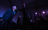 17 DEC 2014 - STOWMARKET, GBR - Dr Feelgood vocalist Robert Kane works the crowd during a gig at the John Peel Centre for Creative Arts in Stowmarket, Suffolk, Great Britain (PHOTO COPYRIGHT © 2014 NIGEL FARROW, ALL RIGHTS RESERVED)