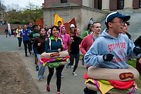 "Students of the Harvard University run in costumes of burgers ""B Good"" in Harvard yard"