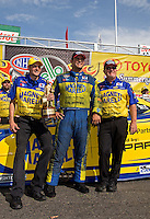 Jun. 2, 2013; Englishtown, NJ, USA: NHRA funny car driver Matt Hagan celebrates with crew after winning the Summer Nationals at Raceway Park. Mandatory Credit: Mark J. Rebilas-