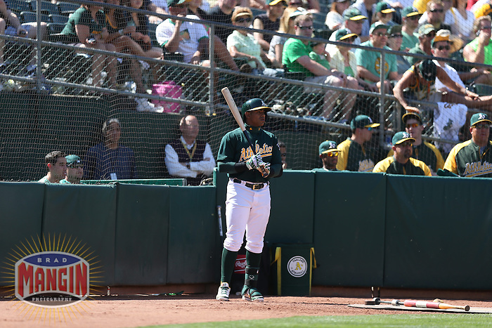 OAKLAND, CA - MAY 1:  Yoenis Cespedes #52 of the Oakland Athletics waits in the on deck circle during the game against the Los Angeles Angels at O.co Coliseum on May 1, 2013 in Oakland, California. Photo by Brad Mangin