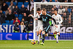 Mateo Kovacic (l) of Real Madrid battles for the ball with David Zurutuza Veillet of Real Sociedad during their La Liga match between Real Madrid and Real Sociedad at the Santiago Bernabeu Stadium on 29 January 2017 in Madrid, Spain. Photo by Diego Gonzalez Souto / Power Sport Images