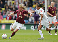Arsenal vs Leeds United - Womens FA Cup Final at Millwall Football Club - 01/05/06 - Arsenal's Leanne Champ (left) gets the better of Jess Clarke - (Gavin Ellis 2006)