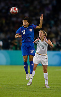 USWNT midfielder (5) Lindsay Tarpley watches Japanese forward (17) Yuki Nagasato head the ball while playing at Worker's Stadium.  The USWNT defeated Japan, 4-2, during the semi-finals of the Beijing 2008 Olympics in Beijing, China.