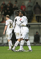 Pictured:  Jason Scotland of Swansea (R) celebrating his equalizer with team mate Jordi Gomez (L)<br /> Re: Coca Cola Championship, Swansea City FC v Barnsley at the Liberty Stadium. Swansea, south Wales, Tuesday 09 December 2008.<br /> Picture by D Legakis Photography / Athena Picture Agency, Swansea 07815441513