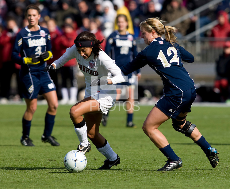 Christen Press (23) of Stanford tries to sprint past Jessica Schuveiller (12) of Notre Dame during the final of the NCAA Women's College Cup at WakeMed Soccer Park in Cary, NC.  Notre Dame defeated Stanford, 1-0.