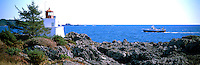 Commercial Fishing Boat passing Amphitrite Point Lighthouse near Ucluelet, BC, on West Coast of Vancouver Island, British Columbia, Canada - Panoramic View