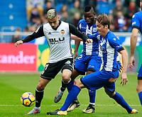 Deportivo Alaves' Wakaso Mubarak (c) and Tomas Pina (r) and Valencia CF's Andreas Pereira during La Liga match. October 28,2017. (ALTERPHOTOS/Acero) /NortePhoto.com