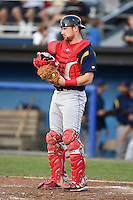 State College Spikes catcher Brian O'Keefe (16) warms up the pitcher in between innings during a game against the Batavia Muckdogs on July 3, 2014 at Dwyer Stadium in Batavia, New York.  State College defeated Batavia 7-1.  (Mike Janes/Four Seam Images)