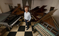 BNPS.co.uk (01202) 558833<br /> Pic: ZacharyCulpin/BNPS<br /> <br /> Pictured: A remarkable collection of rare pianos belonging to the Queen's personal restorer and conservator has emerged for sale for £250,000.<br /> <br /> David Winston is parting with 26 pianos he has amassed over the past 30 years dating from the 18th century to the present day.<br /> <br /> Mr Winston, who was awarded the Royal Warrant in 2012, is regarded as one of the foremost experts in his field and has restored pianos owned and played by Beethoven, Chopin and Liszt.<br /> <br /> His collection includes a 1925 Pleyel grand piano fitted with an original 'Auto Pleyela' self-playing mechanism in a spectacular Chinoiserie Louis XV case valued at 60,000.