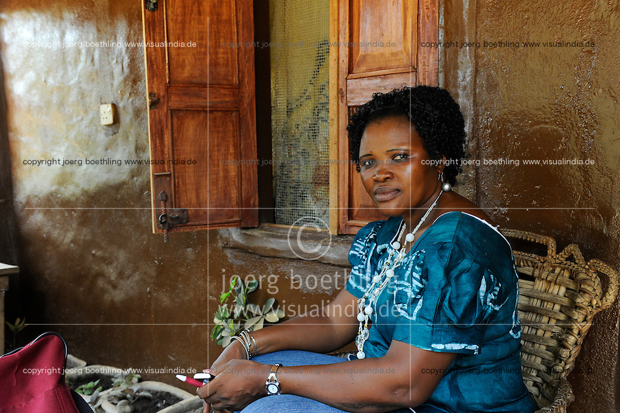 SIERRA LEONE, Tombo, portrait of woman Doris Fatima Webber with batik shirt