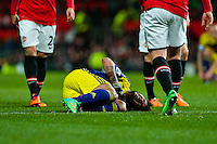 Sunday 05 January 2014<br /> Pictured:Alejandro Pozuelo lies on the floor injured<br /> Re: Manchester Utd FC v Swansea City FA cup third round match at Old Trafford, Manchester