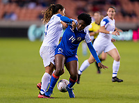 HOUSTON, TX - JANUARY 31: Raquel Rodriguez #11 of Costa Rica fights for the ball with Phiseline Michel #14 of Haiti during a game between Haiti and Costa Rica at BBVA Stadium on January 31, 2020 in Houston, Texas.