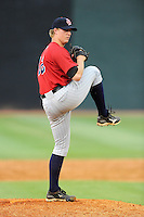Relief pitcher Samuel Clay (12) of the Elizabethton Twins delivers a pitch in a game against the Johnson City Cardinals on Sunday, July 27, 2014, at Howard Johnson Field at Cardinal Park in Johnson City, Tennessee. Clay was a fourth-round pick of the Minnesota Twins in the 2014 First-Year Player Draft. (Tom Priddy/Four Seam Images)