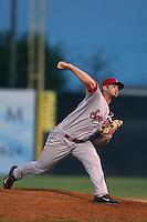 John Fasola #44 of the Spokane Indians pitches against the Salem-Keizer Volcanoes at Volcanoes Stadium on July 26, 2014 in Keizer, Oregon. Spokane defeated Salem Keizer, 4-1. (Larry Goren/Four Seam Images)