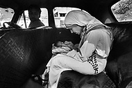 """Calcutta, India. April 04, 1975.<br /> On her morning taxi drive, Mother Teresa is handed a newborn infant  through the car window at a stop by an unknown person. This happens to her almost daily. Mother Teresa (Agnes Gonxha Boyaxihu) the Roman Catholic, Albanian nun revered as India's """"Saint of the Slums,"""" was awarded the 1979 Nobel Peace Prize."""