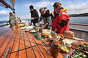 THE BESSIE ELLEN TRAVEL FEATURE.<br /> Lunch on deck off the island of Lunga in the Inner Hebrides, Scotland.<br /> Photo:Clare Kendall<br /> 24/05/2016