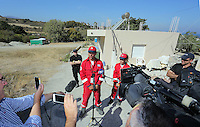 FAO JANET TOMLINSON, DAILY MAIL PICTURE DESK<br />Pictured: Red Cross volunteer Alexis Pantelidis (C) speaks to the press at the start of day seven of the search of a field in Kos, Greece. Sunday 02 October 2016<br />Re: Police teams led by South Yorkshire Police, searching for missing toddler Ben Needham on the Greek island of Kos have moved to a new area in the field they are searching.<br />Ben, from Sheffield, was 21 months old when he disappeared on 24 July 1991 during a family holiday.<br />Digging has begun at a new site after a fresh line of inquiry suggested he could have been crushed by a digger.