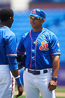 St. Lucie Mets manager Luis Rojas (19) talks with Champ Stuart (2) in between innings during a game against the Brevard County Manatees on April 17, 2016 at Tradition Field in Port St. Lucie, Florida.  Brevard County defeated St. Lucie 13-0.  (Mike Janes/Four Seam Images)