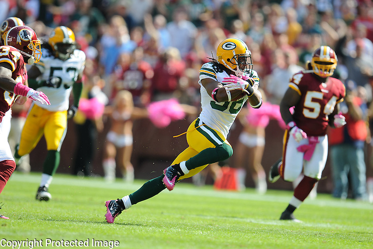 Green Bay Packers' Tramon Williams, center, makes a long punt return against the Washington Redskins during the first quarter of the game at FedEx Field in Landover, Md., on Oct. 10, 2010.