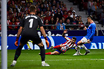 Angel Martin Correa of Atletico de Madrid and Unai Simon (L) and Daniel Garcia (R) of Athletic Club de Bilbao during the La Liga match between Atletico de Madrid and Athletic Club de Bilbao at Wanda Metropolitano Stadium in Madrid, Spain. October 26, 2019. (ALTERPHOTOS/A. Perez Meca)