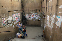 A young man and a boy wait by an underpass in Tbilisi.....