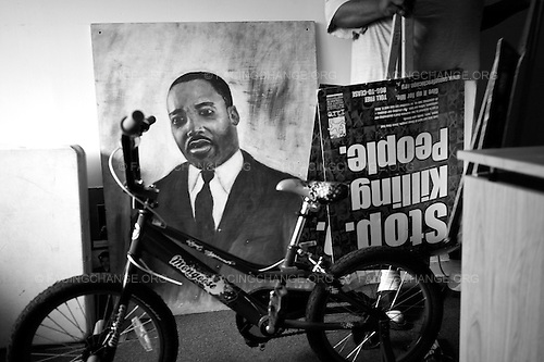 Chicago, Illinois USA<br /> August  2011<br /> <br /> A portrait of Dr. Rev. Martin Luther King sits next to a Stop The Killing poster board. CeaseFire uses a proven public health approach model to stop shootings. After shootings take place CeaseFire interrupters usually gather and march around the neighborhood where shootings take place. CeaseFire interrupters try to calm situations by talking people out of retaliation.