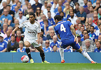 Jefferson Montero of Swansea takes on Cesc Fabregas of Chelsea   during the Barclays Premier League match between  Chelsea and Swansea  played at Stamford Bridge, London