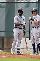 GCL Tigers West Jeremiah Burks (32) and Matthew Jarecki (right) wait at home plate for Jimmy Kerr (not shown) after a home run during a Gulf Coast League game against the GCL Phillies West on July 27, 2019 at the Carpenter Complex in Clearwater, Florida.  (Mike Janes/Four Seam Images)