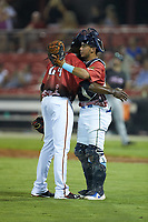 C.D. Pelham (24) of the Down East Wood Ducks gets a hug from catcher Jhonny Pereda (15) of the Myrtle Beach Pelicans after closing out the 2018 Carolina League All-Star Classic at Five County Stadium on June 19, 2018 in Zebulon, North Carolina. The South All-Stars defeated the North All-Stars 7-6.  (Brian Westerholt/Four Seam Images)