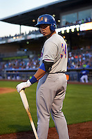 Midland RockHounds designated hitter Renato Nunez (34) on deck during a game against the Tulsa Drillers on June 2, 2015 at Oneok Field in Tulsa, Oklahoma.  Midland defeated Tulsa 6-5.  (Mike Janes/Four Seam Images)