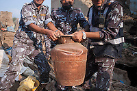 Nepalese police force recovers a jar from a destroyed house. Shanku, near Kathmandu, Nepal. May 9, 2015