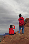 Asian mother and daughter in Arches National Park, Moab, Utah, USA. .  John offers private photo tours in Arches National Park and throughout Utah and Colorado. Year-round.