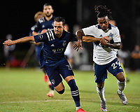 LAKE BUENA VISTA, FL - JULY 26: Luis Martins of Sporting KC and Yordy Reyna of Vancouver Whitecaps FC battle for position as they chase a ball during a game between Vancouver Whitecaps and Sporting Kansas City at ESPN Wide World of Sports on July 26, 2020 in Lake Buena Vista, Florida.