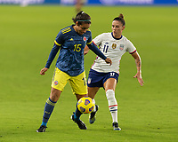 ORLANDO, FL - JANUARY 22: Orianica Velasquez #15 protects the ball from Ali Krieger #11 during a game between Colombia and USWNT at Exploria stadium on January 22, 2021 in Orlando, Florida.