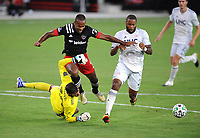 WASHINGTON, DC - AUGUST 25: Matt Turner #30 of New England Revolution saves a shot on goal from Ola Kamara #9 of D.C. United during a game between New England Revolution and D.C. United at Audi Field on August 25, 2020 in Washington, DC.