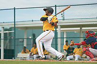 FCL Pirates Gold Gustavo Polanco (35) bats during a game against the FCL Red Sox on July 1, 2021 at Pirate City in Bradenton, Florida.  (Mike Janes/Four Seam Images)