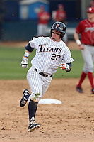 Austin Diemer #22 of the Cal State Fullerton Titans runs the bases during a game against the Washington State Cougars at Goodwin Field on  February 15, 2014 in Fullerton, California. Washington State defeated Fullerton, 9-7. (Larry Goren/Four Seam Images)