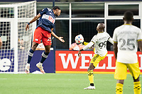 FOXBOROUGH, MA - MAY 16: Bradley Wright-Phillips #99 Columbus SC controls the ball off an attempted header by Jen Bell #22 of New England Revolution during a game between Columbus SC and New England Revolution at Gillette Stadium on May 16, 2021 in Foxborough, Massachusetts.