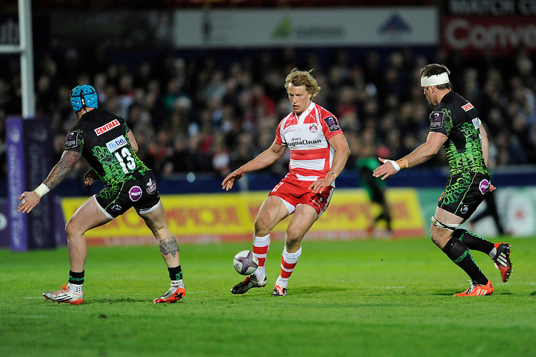 Billy Twelvetrees of Gloucester Rugby chips between Jack Nowell and Kai Horstmann of Exeter Chiefs during the European Rugby Challenge Cup semi final match between Gloucester Rugby and Exeter Chiefs at Kingsholm Stadium on Saturday 18th April 2015 (Photo by Rob Munro)